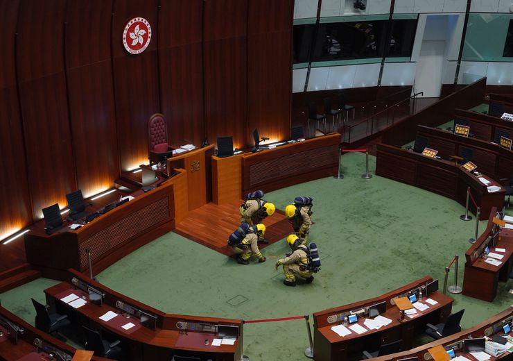 Lawmakers ejected in Hong Kong debate on Chinese anthem bill