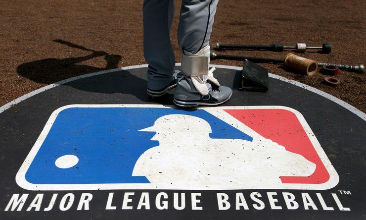 AP Exclusive: MLB plan saves big-spending teams $100M each