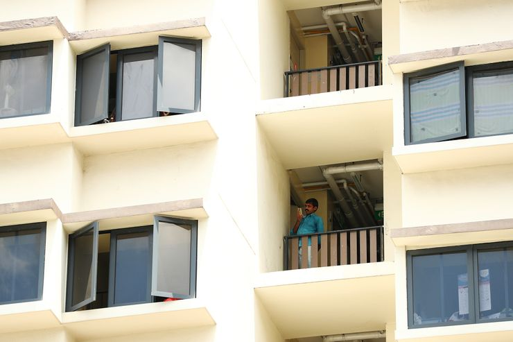 Singapore battles virus hotspots in migrant workers' dorms