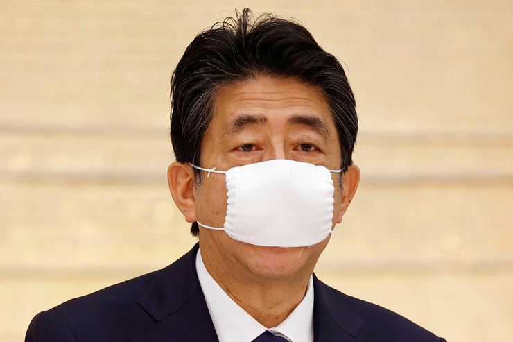 Japan OKs funds for $1.1T stimulus to fight pandemic woes