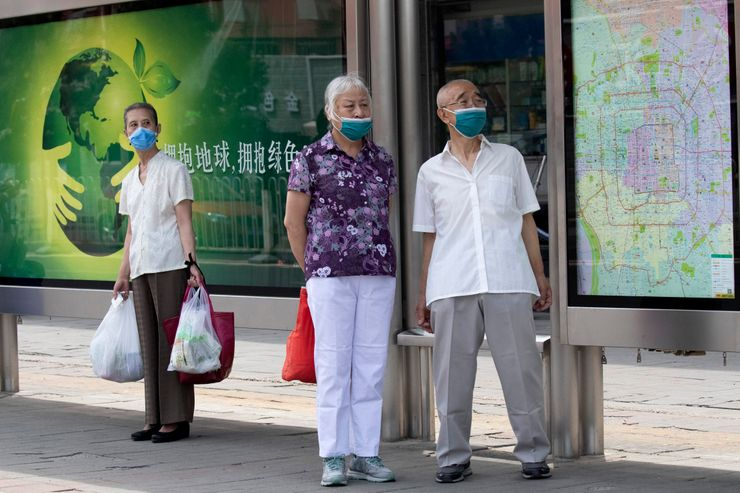 The Latest: Beijing sees slight rise in cases amid outbreak