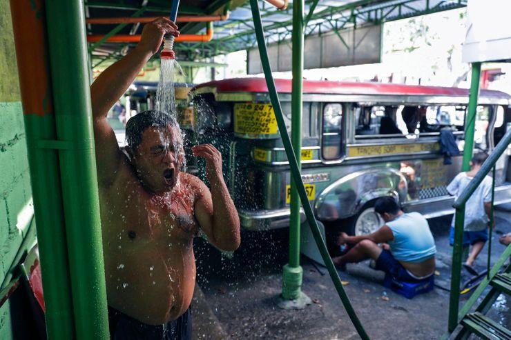 AP PHOTOS: Virus sidelines iconic Philippine jeeps, drivers
