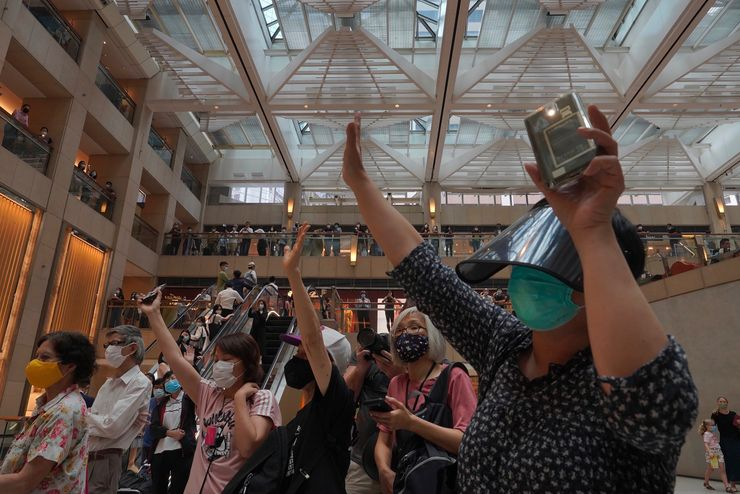 Hong Kong blocks Tiananmen vigil; rush on for UK passports