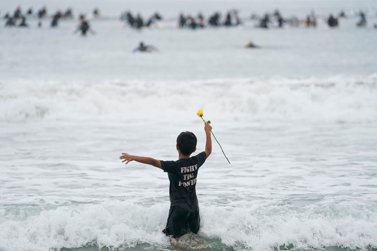 Surfers honor George Floyd in 'paddle out' held around world