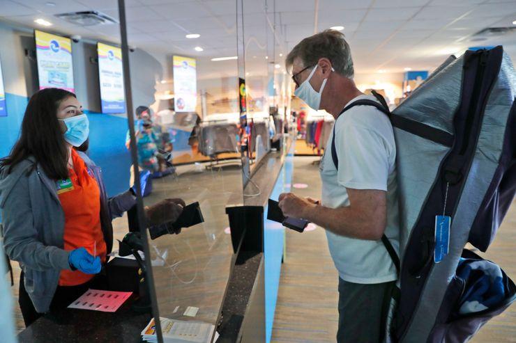 U.S. spending, virus cases after reopenings cloud outlook