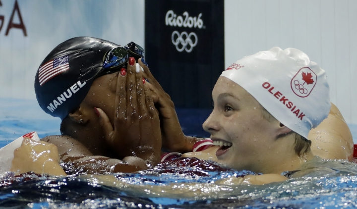 Manuel becomes 1st African American woman to win swim gold
