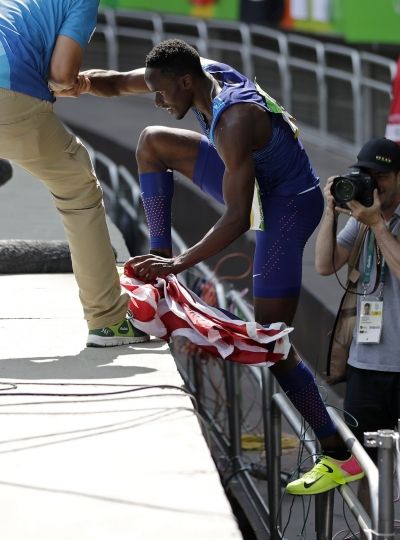 She said yes: Claye proposes after taking Olympic silver