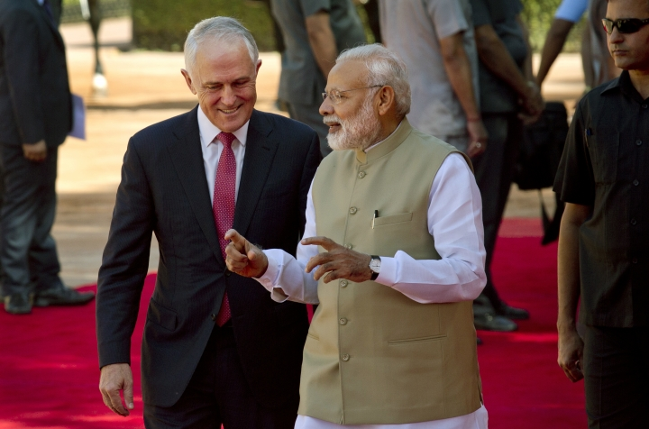Indian Prime Minister Narendra Modi, right, talks to his Australian counterpart Malcolm Turnbull during the ceremonial reception at the Indian presidential palace in New Delhi, India, Monday, April 10, 2017. Turnbull is on a four days official visit to India.(AP Photo/Manish Swarup)
