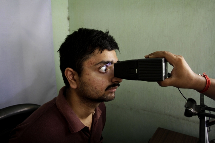 FILE- In this May 16, 2012 file photo, an Indian man gets his retina scanned as he enrolls for Aadhar, India's unique identification project in Kolkata, India. India's top court has ruled that the right to privacy is a fundamental right of every citizen of the country. The landmark verdict was in response to many petitions filed in courts questioning the validity of a government scheme to assign a unique biometric identity card to every individual. (AP Photo/Bikas Das, File)