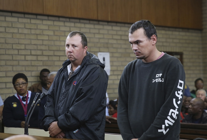 2 white South Africans convicted in coffin assault case