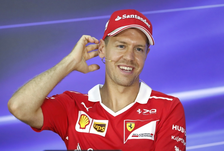 Ferrari driver Sebastian Vettel of Germany smiles during a press conference at Sepang International Circuit for the Malaysian Formula One Grand Prix in Sepang, Malaysia, Thursday, Sept. 28, 2017. (AP Photo/Vincent Thian)