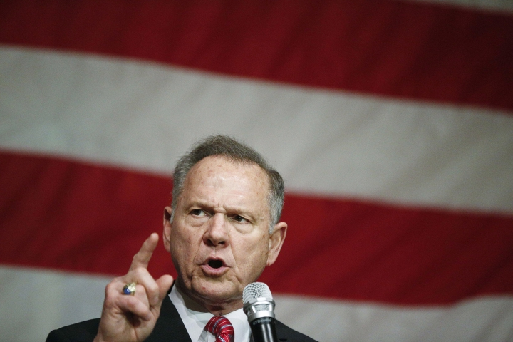 The Latest: Trump robocall urges voters to back Moore